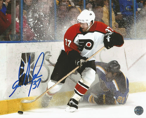 Philadelphia Flyers Eric Desjardins v. St. Louis Blues Autographed NHL Hockey Photo - Dynasty Sports & Framing