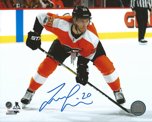 Taylor Leier Faceoff Philadelphia Flyers Autographed Hockey Photo - Dynasty Sports & Framing