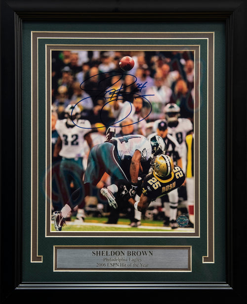 "Philadelphia Eagles Sheldon Brown Crushes Reggie Bush Autographed NFL Football 8"" x 10"" Framed and Matted Photo"