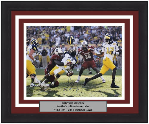 "Jadeveon Clowney South Carolina Gamecocks 'The Hit' v. Michigan Autographed NCAA College Football 2013 Outback Bowl 16"" x 20"" Framed and Matted Photo"