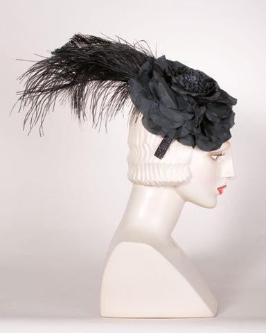 05p10 Whimsy, flower with feather, black