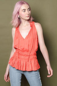 Tangerine Smocked Peplum Top