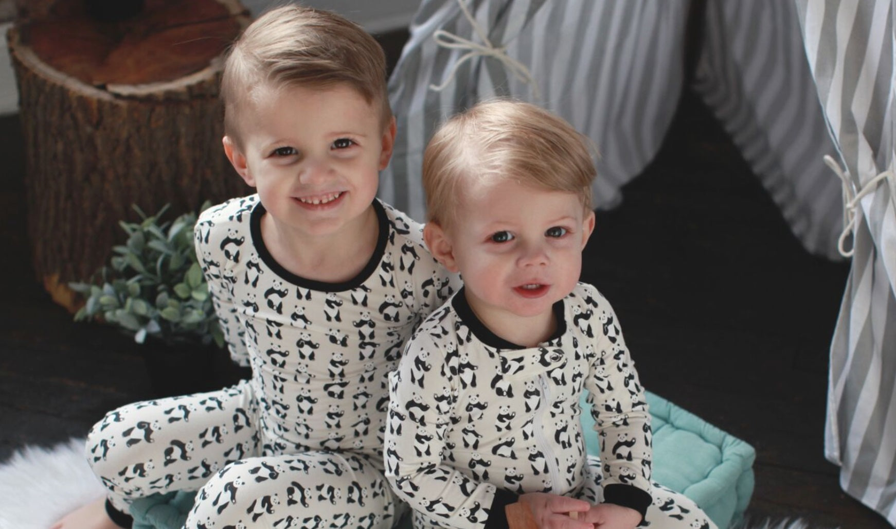 Kids in organic cotton pajamas with panda print