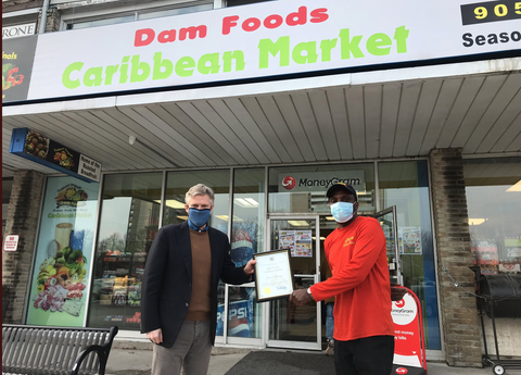 Anthony Miller owner of Dam Foods Caribbean Market with Mayor Rob Phillips in Ajax Ontario at the opening of the store