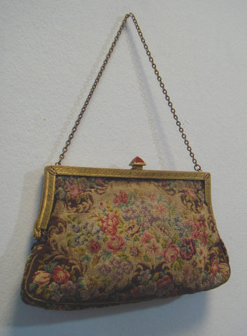 Embroidered bag in early 20th century. Image courtesy: http://throwinthebag.wordpress.com/behind-the-bag/)