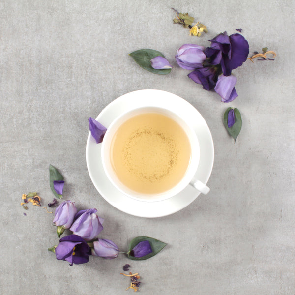 white tea with purple flowers