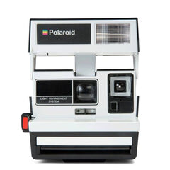 A white vintage Polaroid camera.