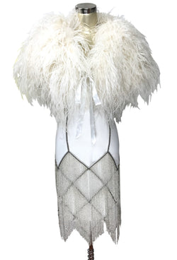 1920s Downton Abbey Dresses THE LOUISE BROOKS CELEBRITY BEADED MESH 1920S GOWN - SILVER ON WHITE $349.95 AT vintagedancer.com
