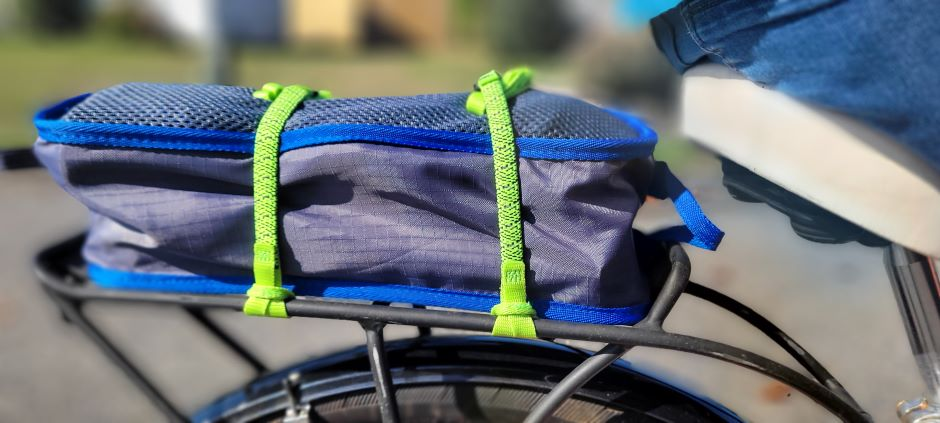 ROK Straps make carrying a camp chair to the park easy on a bicycle.