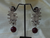 "Indian Jewelry. Contemporary silver earring- ""Pomegranate Blossom"". Silver and white american diamond ear ring. Dangling ruby red Indian ear ring From Artikrti."