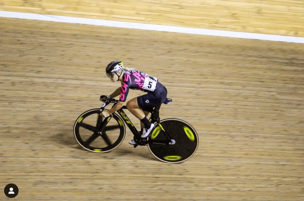 Shannon Cycling around a track