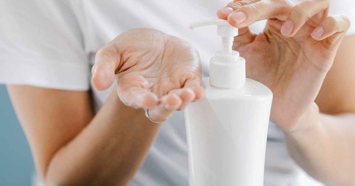 Close up of a woman using body lotion