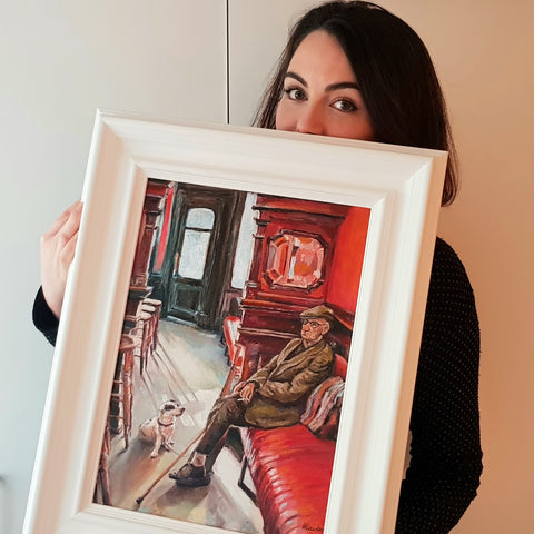 Harriet Lawless Artist Holding an oil painting