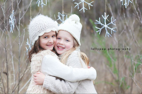 Hugging Sisters by Lollypop Photography