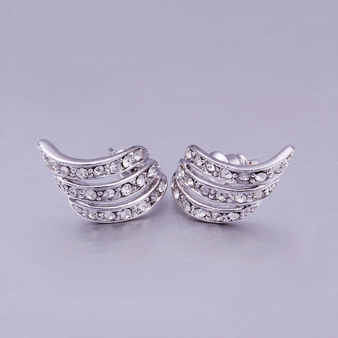 Cutesy Swirl White Gold Stud Earrings