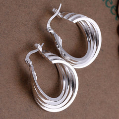 Four coils silver earring