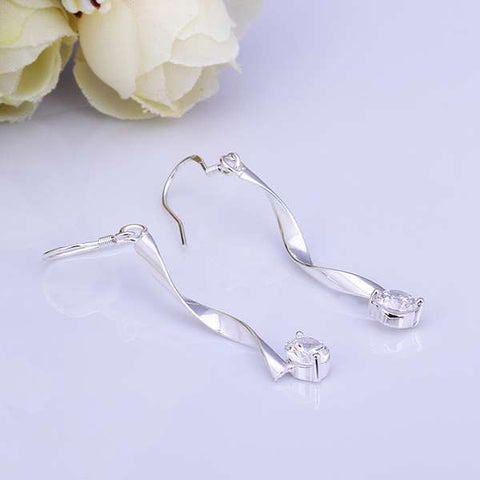 Twisted wire hanging diamond earring