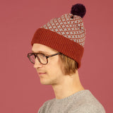 Cross Bobble Hat Rust & Grey + Aubergine Pom Pom