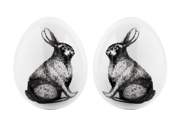 A Pair of White Ceramic Eggs with Rabbit Motif