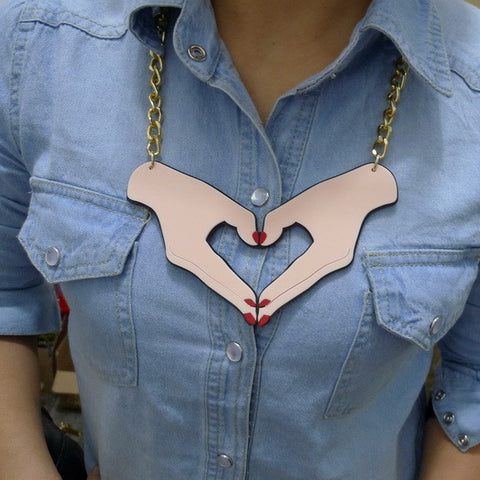 Laser cut acrylic hand heart tattoo style chunky fashion festival necklace on thick gold coloured chain