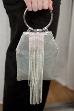 Silver Mesh Handle Bag shown on a model