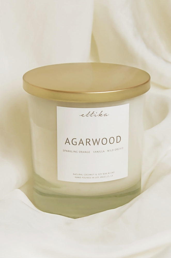Agarwood 8oz Candle on satin background