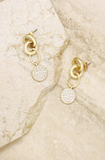 Dangle Crystal Disc 18k Gold Plated Earrings on slate background