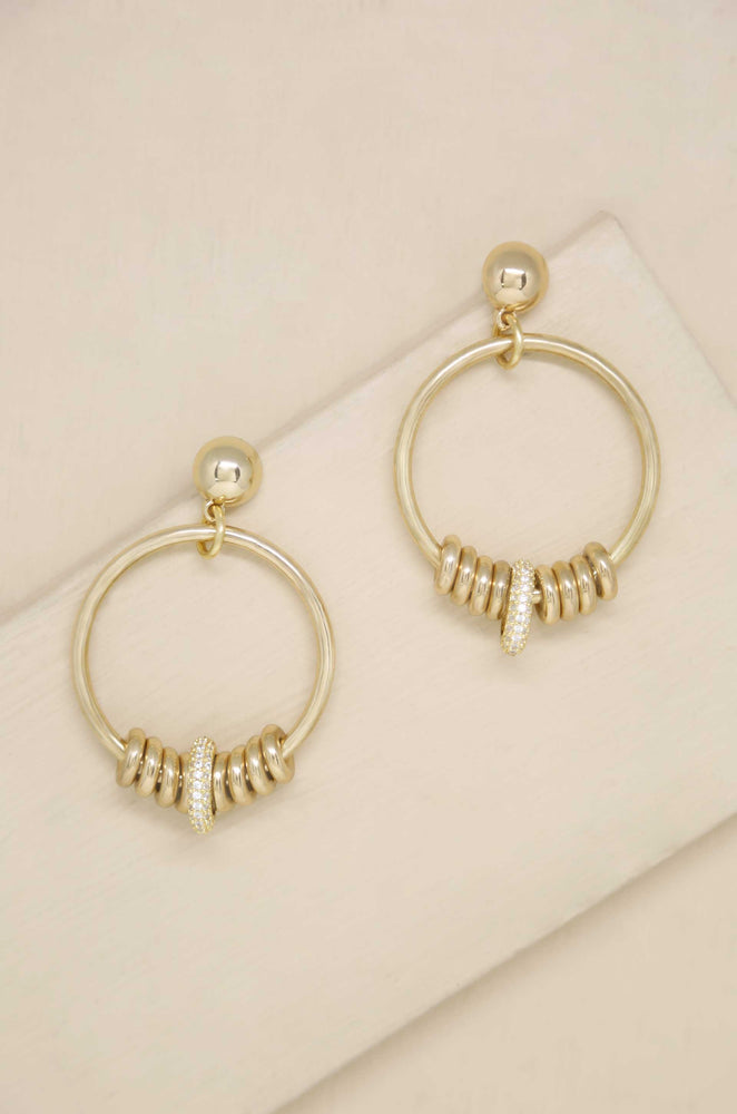 Multi-Ring Slider 18k Gold Plated Earrings on slate background