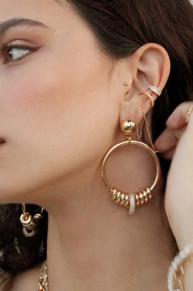 Multi-Ring Slider 18k Gold Plated Earrings shown on a model