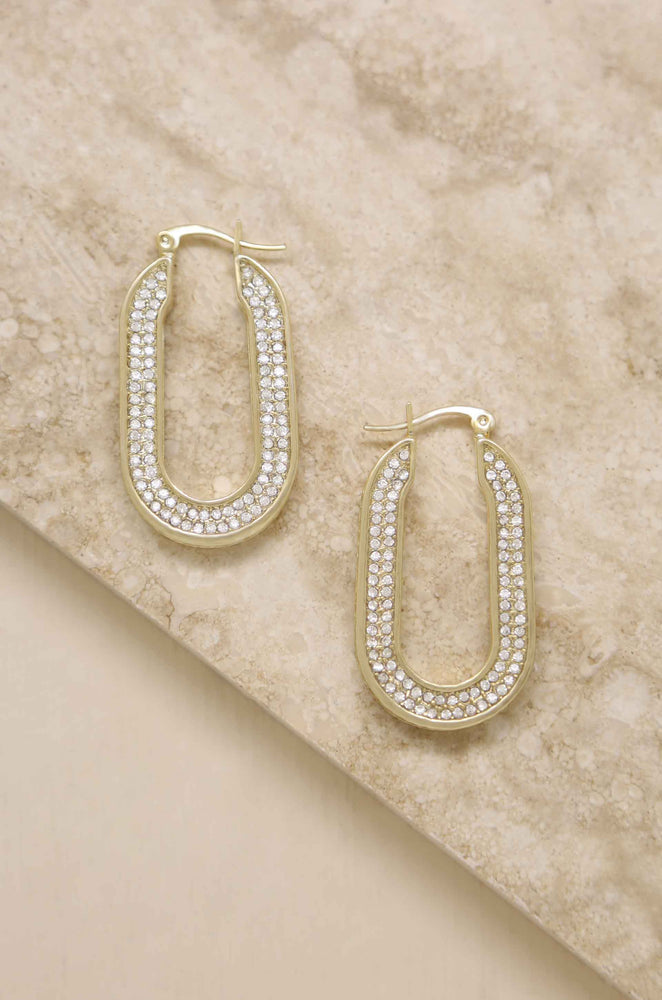 Crystal Spotlight 18k Gold Plated Hoops on slate background