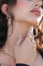 Crystal Spotlight 18k Gold Plated Hoops shown on a model