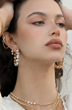 Small Crystal & 18k Gold Warrior Hoop Earrings shown on a model