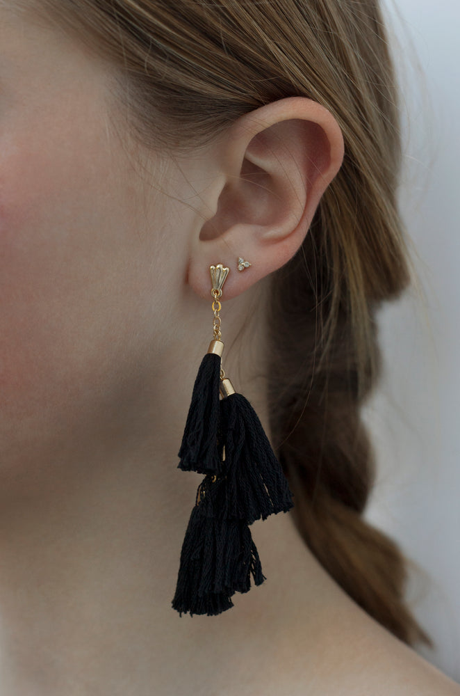 Daydreamer Tassel Earrings in Black and Gold shown on a model