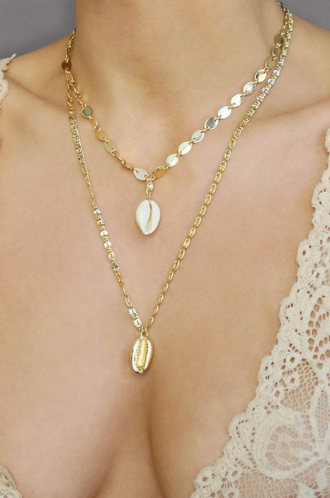 Double Cowrie Shell Layered 18k Gold Plated Necklace Set shown on a model