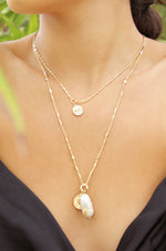 Trusty Trinkets Pearl and Coin 18k Gold Plated Necklace shown on a model