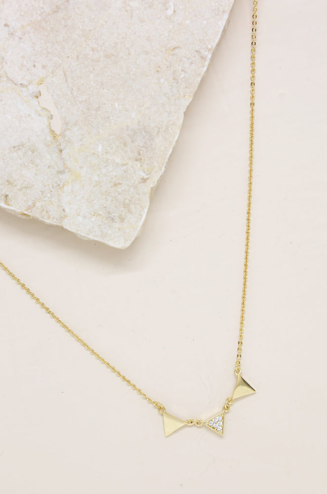 Three Point 18k Gold Plated Crystal Necklace on slate background