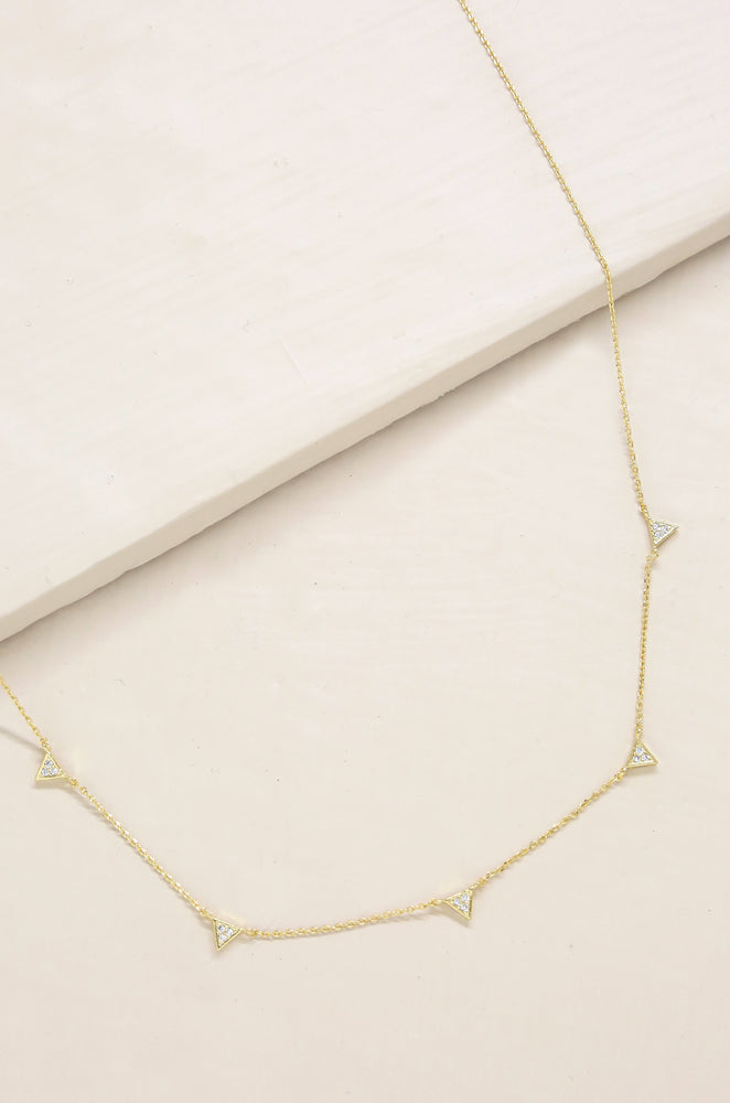 Delicate Addition Crystal Necklace on slate background