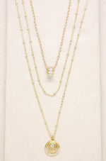 Circles of Crystal Dainty Layered 18k Gold Plated Necklace Set on slate background