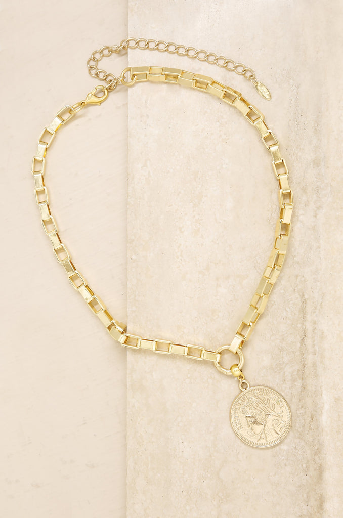 The Traveler's Coin 18k Gold Plated Chain Necklace on slate background