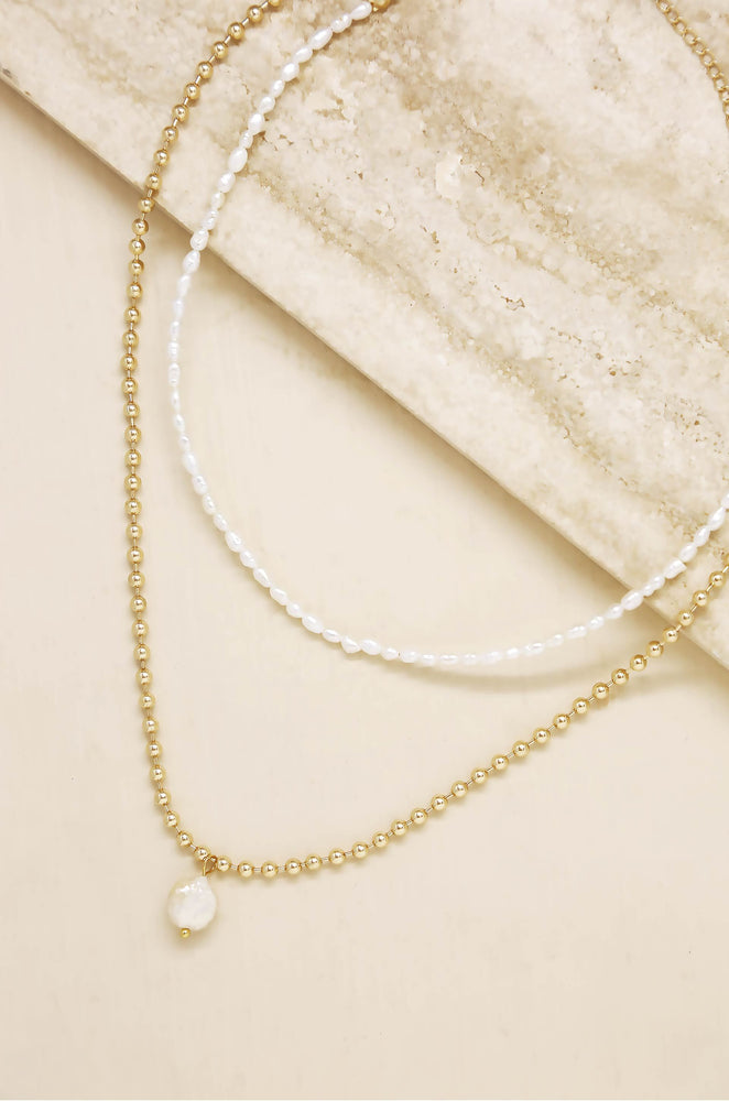 Dainty Pearl Strand and 18k Gold Plated Chain Necklace Set on slate background