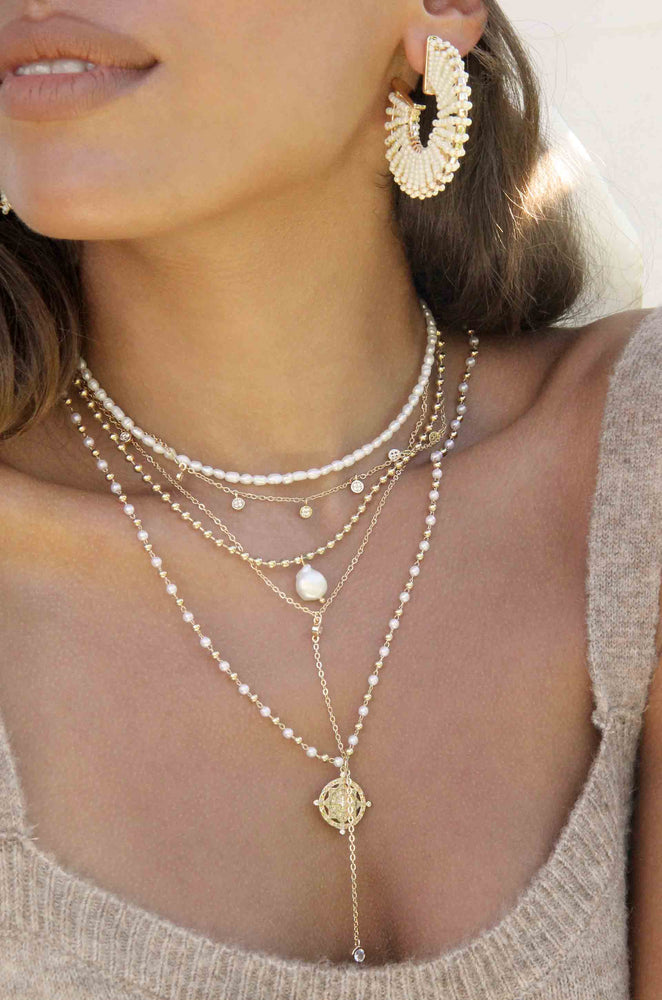 Dainty Pearl Strand and 18k Gold Plated Chain Necklace Set shown on a model