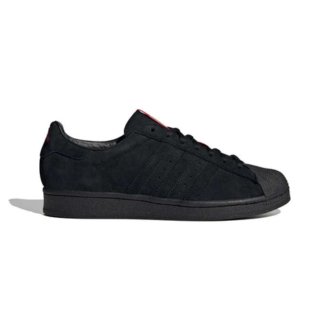 Adidas x Thrasher Superstar ADV - Core Black/Scarlet/Gold Metallic Side