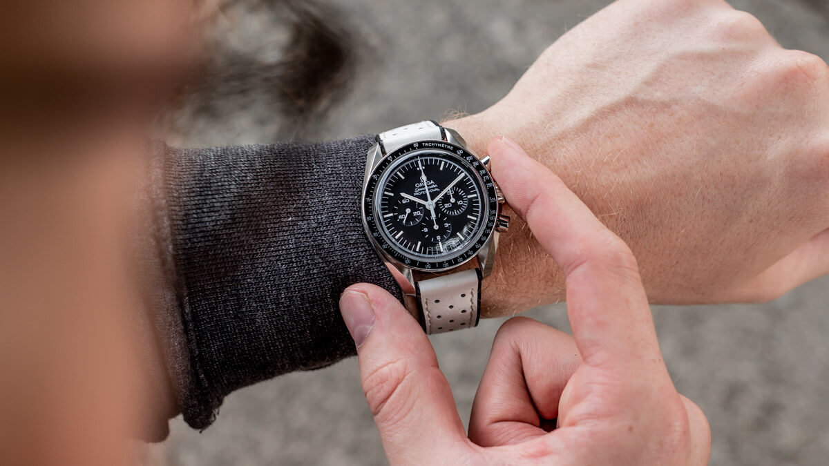 A photogrph of the Omega Speedmaster fitted to the white Flyboard strap from Geckota on wrist.