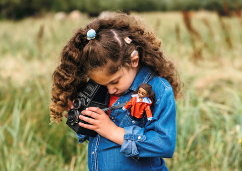girl with Mia wildlife photographer doll