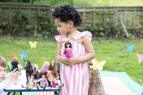 girl playing with spring celebration ballet doll