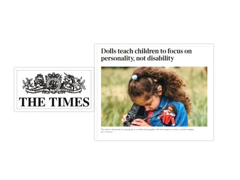 the times with article about Mia wildlife photographer doll