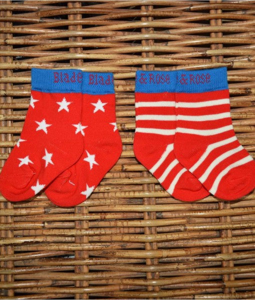 Red, Blue and White socks with stripe and star patterns