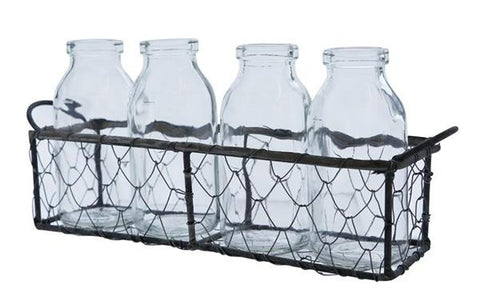 Four Cream Bottles Sitting In A Wire Crate -Decorative Chic for BBQs