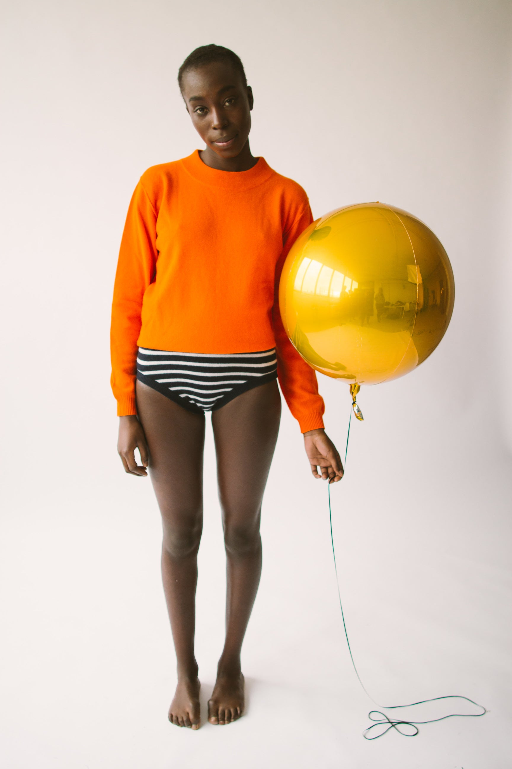 orange almost polo sweater and stripe knickers
