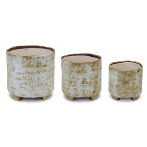 photo of all 3 sizes of small round pot with rustic white and amber finish and small legs underneath